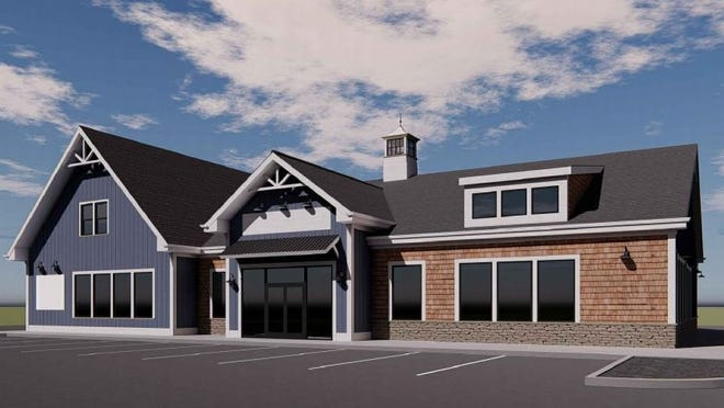 An artist rendering of a proposed retail complex that will include a 6,000 square-foot convenience store and gas station with a drive-through doughnut shop, five gasoline filling pumps, a 3,500 square-foot bank and an 11,250 square-foot mixed-used building is being built at 34-38 Padelford St., next door to Haskins Farms, directly across from the highway exits.