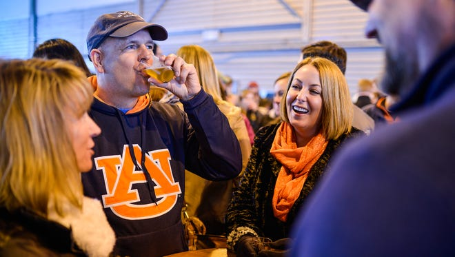 Angie Hofman, from left, Jim Gibson, Shauna VanHoose, and Clinton Hofman, all of Louisville, enjoy each other's company during the Tailspin Ale Fest at Bowman Field. The festival features 56 breweries from across the country.