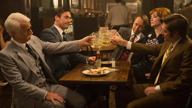 John Slattery as Roger Sterling, Jon Hamm as Don Draper, Vincent Kartheiser as Pete Campbell, Christina Hendricks as Joan Harris and Kevin Rahm as Ted Chaough on AMC's series 'Mad Men.'