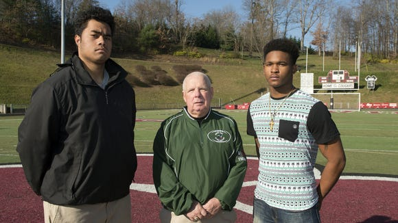 Reynolds senior Rico Dowdle, right, will play in Saturday's Shrine Bowl of the Carolinas all-star football game in Spartanburg, S.C. Pictured with him are Asheville High lineman Pete Leota and Cougars assistant coach Charlie Metcalf who are also Shrine Bowl participants.