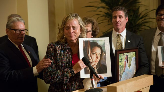 In this Sept. 11, 2015 file photo, Debbie Ziegler, mother of Brittany Maynard, speaks to the media after the passage of legislation, which would allow terminally ill patients to legally end their lives, at the state Capitol, in Sacramento, Calif.