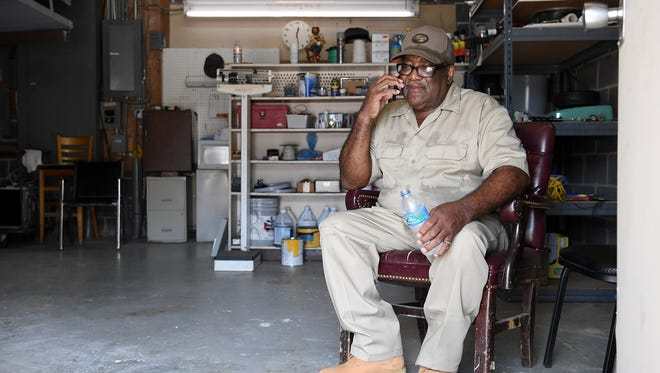 Paul Poore plans a service request as he takes a quick break for a drink of water in the maintenance room of the Westgate Shopping Center on Wednesday, Aug. 30, 2017.  Poore started working at the center in 1960 at the age of 18. As he's gotten older he tries to do as much at the shopping center as he can.