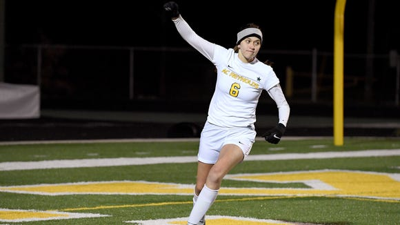Reynolds' Annabelle Sparks celebrates a goal on North Henderson during their game at Reynolds High School on Wednesday, March 7, 2018. The Rockets defeated the Knights 9-0 in almost 45 minutes of play.