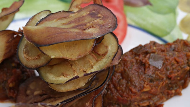 Singh Farm's Aubergine dip features fried eggplant chips, as seen in Scottsdale on Oct. 7, 2014.