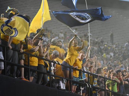 Nashville SC fans celebrate after a goal during the