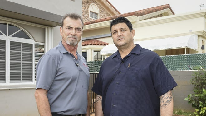 """Neighbors Gabriel Simon, left, and Alfredo Bustamante join forces to express concern about underground tourism in their neighborhood in Tamuning on Jan. 21. The pair suspects two underground bed-and-breakfasts are currently operating on their street. """"If you don't respect our culture and laws, as a local, then I have a problem,"""" said Bustamante."""