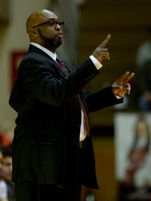 Richmond boys basketball coach Rick Wedlow talks to players during a game against Shelbyville Friday, Jan. 22, 2016 in the Tiernan Center.