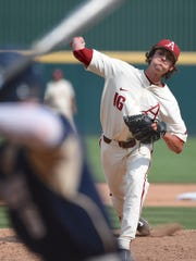 Razorback right-hander Blaine Knight delivers a hard