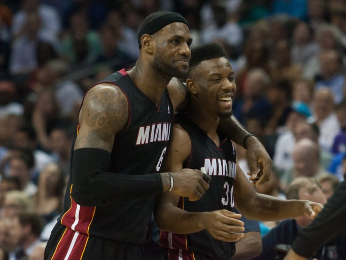 Game 4 in Charlotte -- Heat 109, Bobcats 98: LeBron James (6) and Norris Cole (30) celebrate  Miami's first-round sweep.
