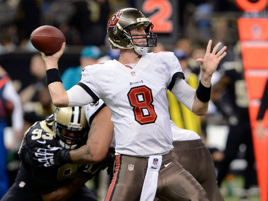 FILE - In this Dec. 29, 2013 file photo, Tampa Bay Buccaneers quarterback Mike Glennon (8) passes under pressure from New Orleans Saints outside linebacker Junior Galette (93) in the second half of an NFL football game in New Orleans. Glennon says he's not discouraged by the Buccaneers' decision to bring in Josh McCown as the team's new starter.(AP Photo/Bill Feig, File)