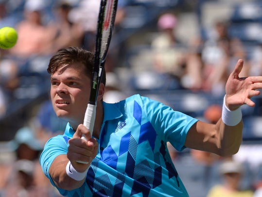 Milos Raonic, of Canada, returns a volley against Andy Murray, of Great Britain, during a fourth round match at the BNP Paribas Open tennis tournament, Wednesday, March 12, 2014, in Indian Wells, Calif. (AP Photo/Mark J. Terrill)