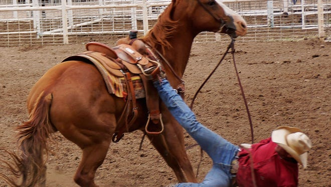 """On its own, the word """"wreck"""" conjures up endless images of smoke, dust, and cussing, blood and disaster. When you throw in the words cowboy, horse and rope, it becomes not a picture, but a definition. Cowboy defined."""