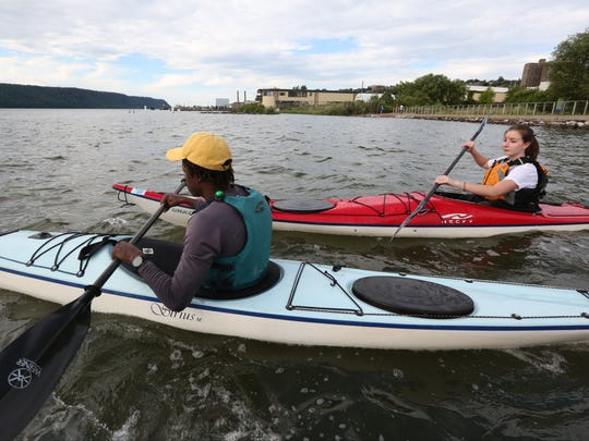 Chevaughn Dixon teaches Katherine Develaeminck water-rescue techniques at the Yonkers Paddling and Rowing Club.