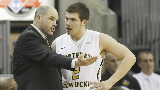 This file photo shows NKU coach Dave  Bezold talks with Tayler Persons during the Norse basketball game against West Virginia.