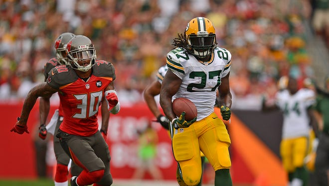 Green Bay Packers running back Eddie Lacy runs away from Tampa Bay Buccaneers safety Bradley McDougald (30) for a 44-yard touchdown in the first quarter during Sunday's game at Raymond James Stadium in Tampa, Fla.
