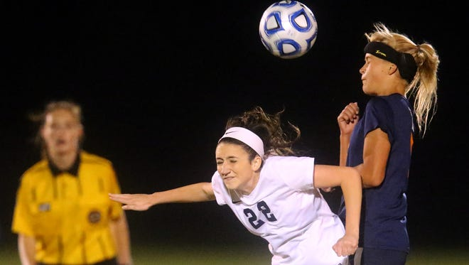Siegel's Bella Roberts (left) scored the Lady Stars' first-half goal during Saturday's Class AAA Sectional contest at McMinn County.
