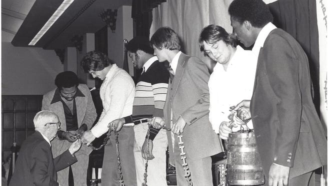 Pop Doan, an early member of the Lafayette Kiwanis Club and a Purdue Athletic Hall of Fame, adds a P to the chain on the Old Oaken Bucket in 1978. The Kiwanis Club continues to host the postseason recognition banquet.