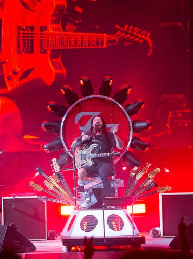 """After breaking his leg in Sweden this summer Dave Grohl performs from the """"throne"""" during the Foo Fighters  Sonic Highways Tour Friday, Sept. 25, 2015 taking place at the Ak-Chin Pavilion in Phoenix."""