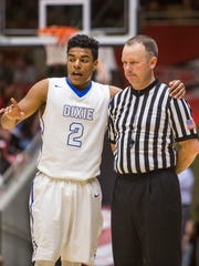 Dixie's Malachi Otis talks with an official during the game against Bear River in Friday's 3A semifinal matchup at the SUU Centrum, Feb. 26, 2016.