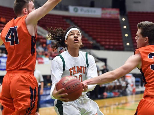 FAMU DRS's Mekhi Yant splits Bradenton Christian defenders J.T. Noellert, left, and Ryan Leunk during the Rattlers' 61-44 loss to the Panthers in Tuesday's Class 2A state semifinal game.