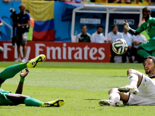 Colombia's Teofilo Gutierrez, right, tries to kick the ball while on the ground during the group C World Cup soccer match between Colombia and Ivory Coast at the Estadio Nacional in Brasilia, Brazil, Thursday, June 19, 2014.  (AP Photo/Sergei Grits)