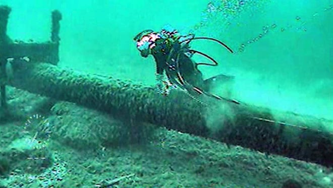 Enbridge says its Pipeline 5 -- which carries millions of gallons of oil and natural gas each day and located under the Mackinac Straits --  is completely safe. This photo filmed last summer shows a diver inspecting the 62-year-old pipleline.