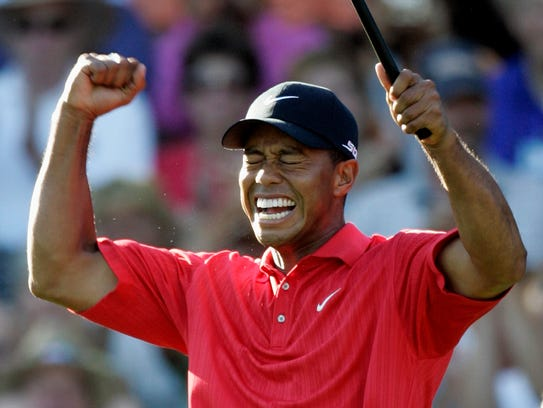 Tiger Woods celebrates after winning 88th PGA Championship