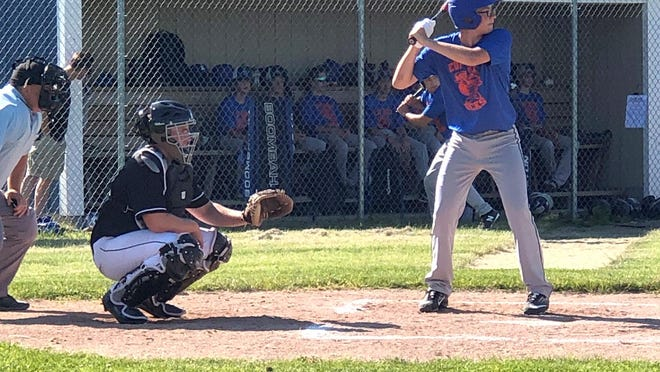 Dominic Haller of the EUP Wood Ducks steps up to the plate, while EJ Suggitt sets up at catcher for GFL during the opening game of a doubleheader at Laucks Field Thursday. Haller picked up one of his two hits in the first game during this at-bat. The Wood Ducks and GFL split the twinbill.