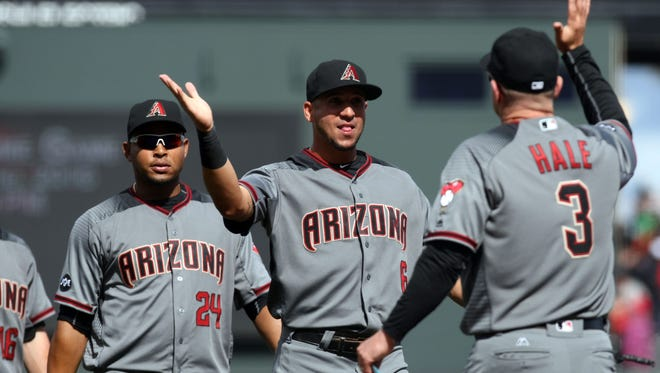 Apr 21, 2016: Arizona Diamondbacks right fielder David Peralta (6) is greeted by his manager Chip Hall (3) after defeating the San Francisco Giants 6-2 at AT&T Park.