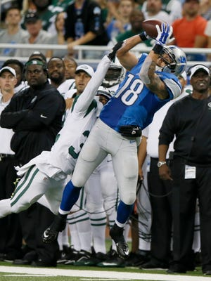 Detroit Lions wide receiver Greg Salas  makes a first down pass reception over New York Jets Dashaun Phillips in the third quarter of their pre season football game on Thursday, August 13, 2015, in Detroit. Julian H. Gonzalez/Detroit Free Press