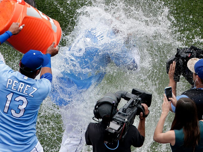 July 7: Royals' Paulo Orlando  is drenched by Salvador