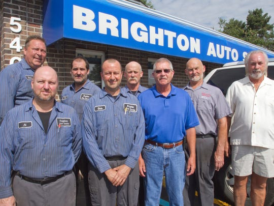 The staff at Brighton Auto Service is celebrating 30 years in business. Pictured are, front row from left, technician Alan Abdella, technician Chris Donovan, service writer Rick Knight, vice president Bill Wasylyk, president Bob Keeney; back row from left, technician Mark Boon, technician Tom Summers and technician George Vieira.