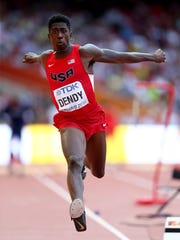 Marquis Dendy takes flight in the triple jump competition