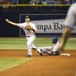 Toronto Blue Jays' Jose Bautista interferes with the Tampa Bay Rays' second baseman in St. Petersburg, Fla., on April 5, 2016.