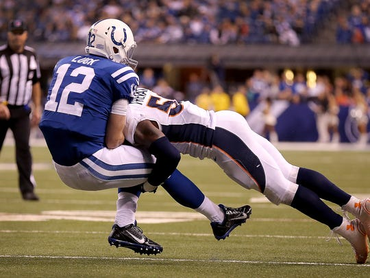 Andrew Luck is hit by Broncos inside linebacker Danny Trevathan (59), Nov. 8, 2015, at Lucas Oil Stadium.