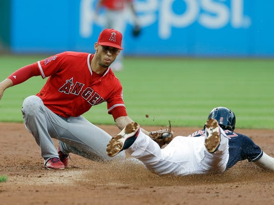 Los Angeles Angels' Andrelton Simmons, left, tags out Cleveland Indians' Erik Gonzalez on a steal to second base in the third inning of a baseball game, Wednesday, July 26, 2017, in Cleveland. (AP Photo/Tony Dejak)