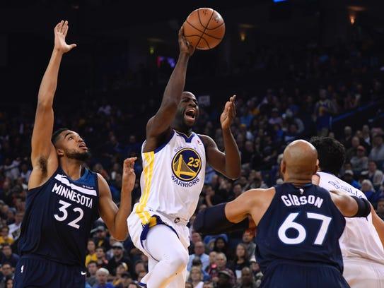Golden State Warriors forward Draymond Green (23) shoots