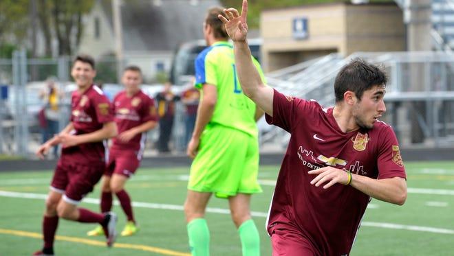Zach Schewee celebrates after scoring a goal earlier in the season.