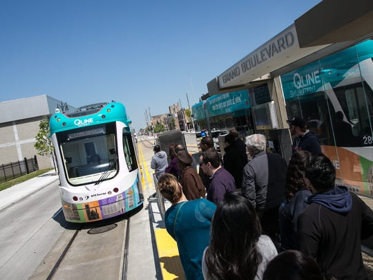 People ride the QLINE during the grand opening festivities