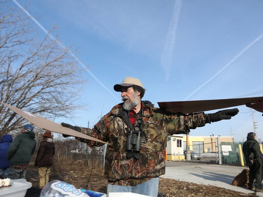 Don Torino of Moonachie, president of the Bergen County Audubon Society, shows the wingspan of an adult eagle during a gathering in Ridgefield on  Sunday, Jan. 21, 2018.