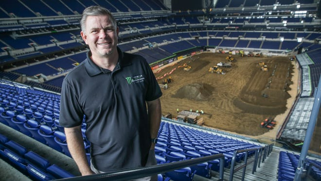 Director of Operations for Monster Energy AMA Supercross, Tim Phend stands in Lucas Oil Stadium where his crews work at a breakneck pace to construct the Supercross track on Wednesday, March 21, 2018. Monster Energy AMA Supercross will be racing at the stadium on March 24, 2018.