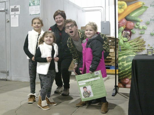 Manitowoc Minute comedian Charlie Berens poses for pictures as part of a food drive at the Sheboygan County Food Bank.