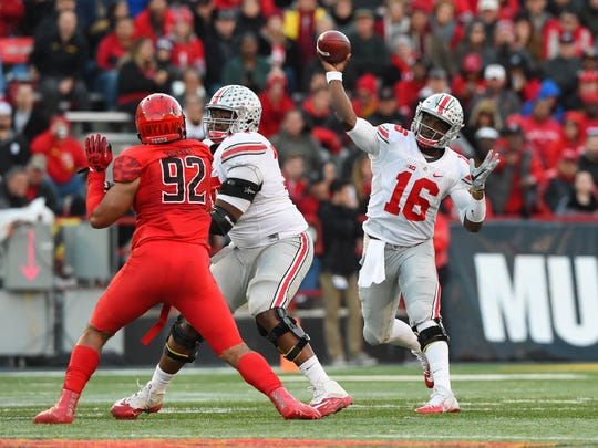 Ohio State quarterback J.T. Barrett uncorks a pass during a first half in which he accounted for four touchdowns on Saturday.
