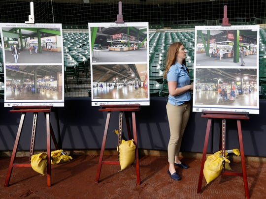 Jacque Lefeber, a manager of special events, adjusts the renderings before the news conference.