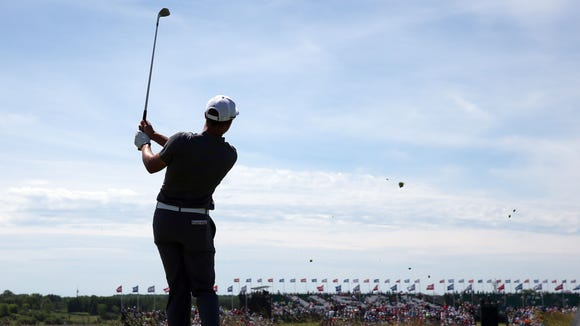Cameron Champ plays his shot from the ninth tee during
