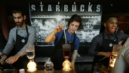 FILE - In this Wednesday, March 23, 2016, file photo, Starbucks workers prepare coffee using siphon vacuum coffee makers at a station in the lobby of the coffee company's annual shareholders meeting in Seattle. Starbucks says that it will be boosting the base pay of all employees and store managers at U.S. company-run stores by 5 percent or more on Oct. 3. In a letter sent to workers on Monday, July 11, 2016, CEO Howard Schultz said that the amount of the raise will be determined by geographic and market factors.