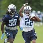 Titans running back Dexter McCluster (22) catches a pass against Sean Spence (55) during practice at Saint Thomas Sports Park on Thursday, May 26, 2016.