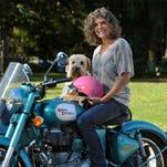 Cancer survivor Lori Elder and her dog Erin go bragh.