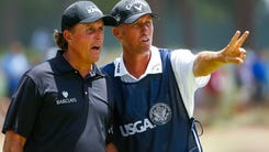 epa06042099 (FILE) - Phil Mickelson of the US (L) and his caddie Jim Mackay (R) talk on the seventh tee during the first round of the 2014 US Open Championship on the Pinehurst No. 2 course at the Pinehurst Resort and Country Club in Pinehurst, North Carolina, USA, 12 June 2014. According to joint statements Mickelson and Mackay have mutually decided to end their 25 year golfer-caddie relationship and part ways. Mickelson's younger brother Tim is expected to take up the hall of fame golfer's bag.  EPA/ANDREW GOMBERT ORG XMIT: thm01