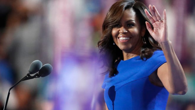 First lady Michelle Obama takes the stage during the first day of the Democratic National Convention in Philadelphia on Monday.